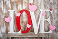 Love word with hearts on wooden planks background Royalty Free Stock Photo
