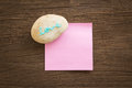 Love word pebble with blank notepad on wood background blue glitter pink place vignette valentine s day symbol Royalty Free Stock Photos