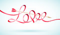 Love word ribbon with cupids arrow flying through it Stock Photo