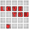 Love you in grid big red letters on the white shelf Stock Photography