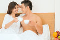 Love you my dear image of a happy couple drinking morning coffee in bed Royalty Free Stock Photography