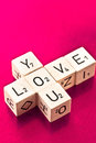 Love you written on wooden dice Royalty Free Stock Photo