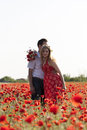 Love a young couple in a poppy field Royalty Free Stock Photography