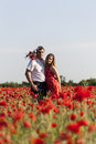 Love a young couple in a poppy field Stock Photos