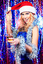 Loveliness pretty girl in christmas clothes on a party disco lights in the background Stock Photos