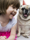 A lovely adorable young child with pug Royalty Free Stock Photo