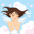 Lovely angel girl beautiful flying between clouds and hearts in peaceful heaven Stock Images