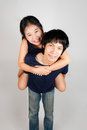 Lovely asian thai spouse wife rides pickaback her husband Royalty Free Stock Photography