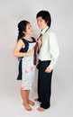 Lovely asian thai spouse wife ties husband s necktie with plenty of love Stock Photos