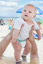 Lovely baby boy outdoor on beach in summer Stock Photography