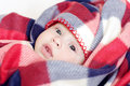 Lovely baby in checkered plaid four months Royalty Free Stock Photography
