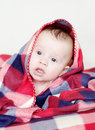 Lovely baby covered by checkered plaid four months Royalty Free Stock Images
