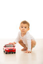 Lovely baby playing with car toy boy a big on floor Royalty Free Stock Image