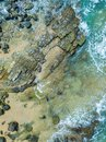 Lovely beach aerial shot of water and rocks