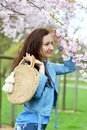 Lovely Beautiful Caucasian Woman Standing Posing on the Background of Blooming Japan Cherry Royalty Free Stock Photo