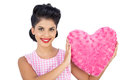 Lovely black hair model holding a pink heart shaped pillow Royalty Free Stock Photo