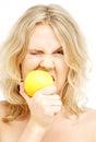 Lovely blond biting lemon Royalty Free Stock Photo
