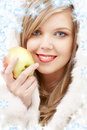 Lovely blond in fur with apple Royalty Free Stock Images