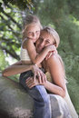 Lovely blonde young girl and mother hug outdoor Stock Image