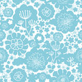 Lovely blue florals silhouettes seamless pattern vector with hand drawn flowers on light background Stock Photos