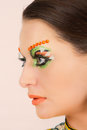 Lovely brunette woman portrait with creative make up and orange spots Royalty Free Stock Photos