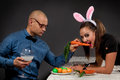 Lovely bunny couple men in rabbit costume is feeding his girlfriend Royalty Free Stock Photo