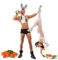 Lovely bunny couple in rabbit costumes with carrots Stock Photo