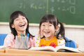 Lovely childrens in the classroom happy and Royalty Free Stock Images