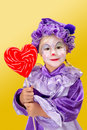 Lovely clown girl holding heart shape lollipop valentine s day Stock Image
