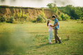 Lovely couple at green picturesque village kiss Stock Images