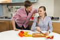 Lovely couple on kitchen Royalty Free Stock Photos