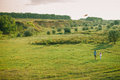 Lovely couple play with sky air kite at green meadow picturesque landscape in countryside Royalty Free Stock Photography