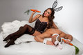Lovely couple rabbit costumes bed Royalty Free Stock Photography