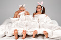 Lovely couple rabbit hiding their faces under blanket Royalty Free Stock Photography