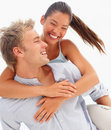 Lovely couple smiling over a white Stock Images