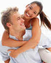Lovely couple smiling over a white Royalty Free Stock Image