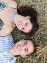 Lovely couple in straw Royalty Free Stock Photo