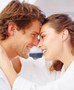 A lovely couple in white arms around each other Stock Image
