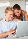 A lovely couple working on a laptop Royalty Free Stock Images