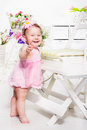 Lovely emotional toddler girl pink dress Stock Photo