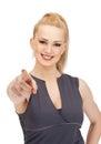 Lovely fitness instructor pointing her finger