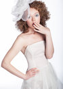 Lovely girl bride with bow posing. Series of photo Stock Image