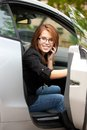 Lovely girl with cell phone in car Royalty Free Stock Photo