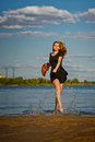 Lovely girl coming out of river. Royalty Free Stock Photo