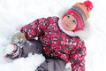 Lovely girl has a fun in snow cute Stock Images