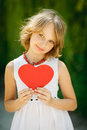 Lovely girl holding heart shape romantic outdoors Stock Image
