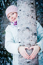 Lovely Girl Hugging a Tree in Forest Royalty Free Stock Photo