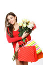 Lovely girl shopping bags roses white background Stock Photos