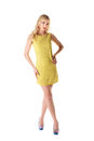 Lovely girl in yellow summer dress isolated on white Royalty Free Stock Photo