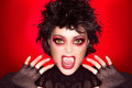 Lovely gothic girl vampire makeup caricature beautiful of screaming with fancy wolf lenses and big fangs Stock Images